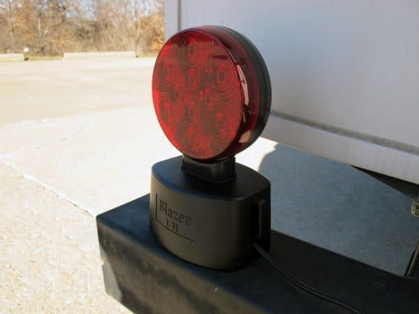 Magnetic tow lights mount onto a variety of metal surfaces